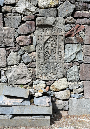 stone tombstone: Ancient armenian tombstone in the monastery stone wall
