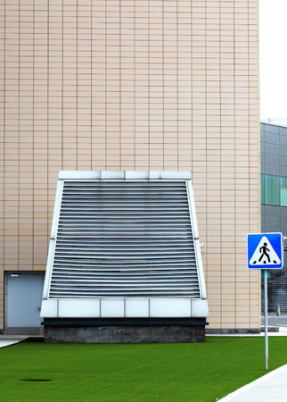 Ventilation device by the wall  of an industrial building photo