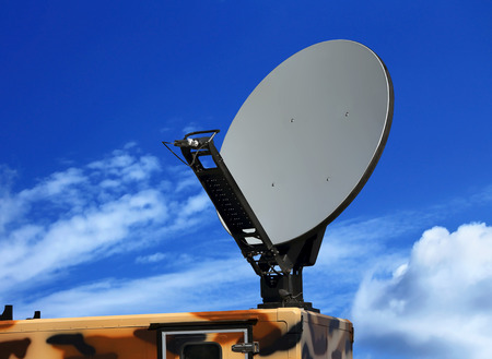 Dish antenna of the military mobile device satellite communication with a metallic reflex reflector in operation Stock Photo