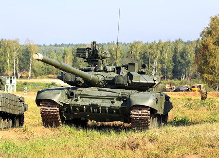 tracked: Russian main battle tank T-72 on the training camp Editorial