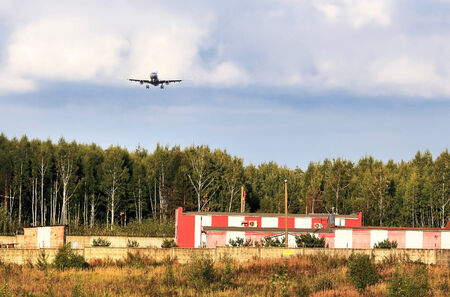 aircraft landing: Engineering building at the airport in the area of aircraft landing
