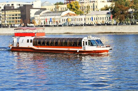 Pleasure boat on the river on a summer evening photo