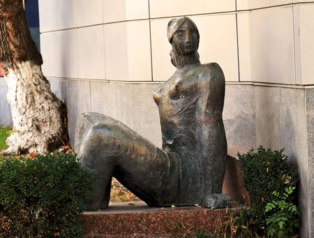 armenian woman: Bronze figure of a seated girl in a city park