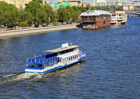Pleasure boat on the river on a summer day photo