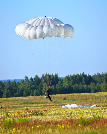 paradglider: Skydiver descends by parachute. Time just before landing Stock Photo