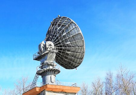 airwaves: Dish antenna of mobile device satellite communication with a metallic reflex reflector in operation