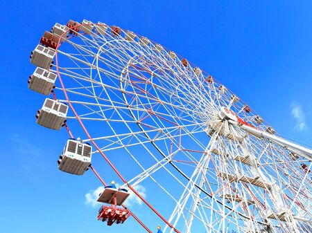movable: Movable ferris wheel without people in the city park Stock Photo