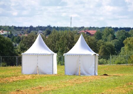 appointed: Two white tents at the exhibition camp appointed as pavilions Stock Photo