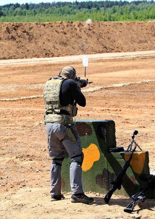 machine gun: Sportsman at the shooting range firing from  machine gun
