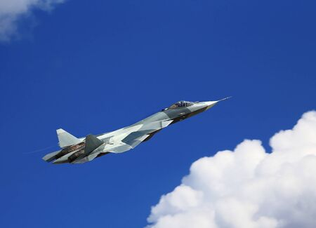 modern fighter: Modern russian fighter T-50 flying in a cloudy sky Editorial