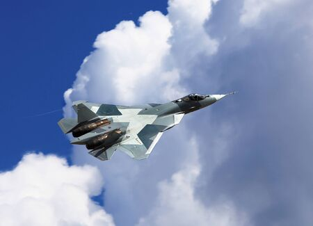 modern fighter: Modern russian fighter T-50  flying in a cloudy sky