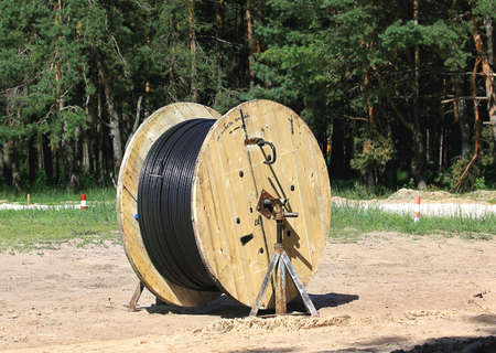 powerline: Bulk of cable and  for laying of underground powerline Stock Photo