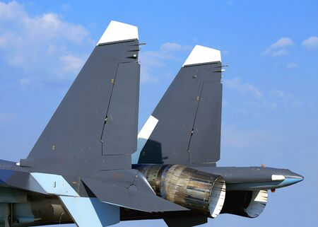 thrust: Back of the fighter with the adjustable jet nozzle with thrust vector control Stock Photo