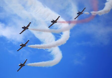 aerobatics: Perform aerobatics by the aircraft team in the blue sky