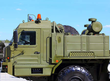 forepart: Heavy army truck with a device for trailer docking Editorial