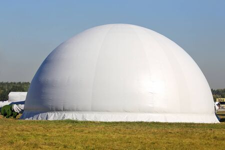 tightly: Air dome - a flexible shell of durable reinforced fabric, tightly fastened to the foundation