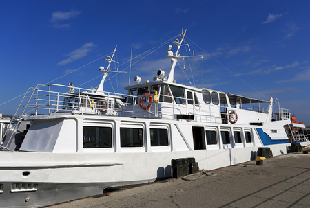 berth: Motor  marine vessel anchored at the sea berth Stock Photo