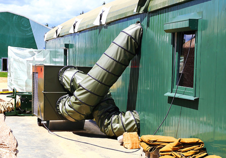 Ventilation pipes and actuators for the army medical aid station in a tent Stock Photo