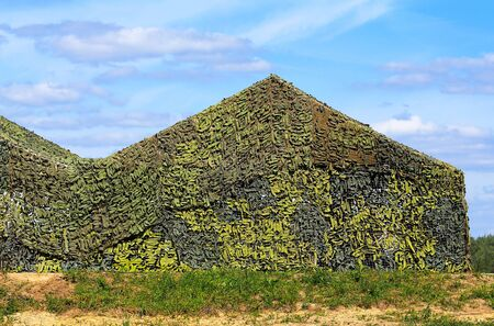 net: Camouflaged military screening netting at the army training camp