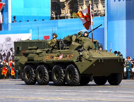 armoured: MOSCOW - MAI 7: Column of military hardware consisting of a russian armoured vehicles for infantery transportation - on Mai 7, 2015 in Moscow