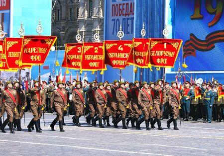 solemn: MOSCOW MAI 7: Troops in military uniform of World War II in solemn march on Red Square - on Mai 7, 2015 in Moscow