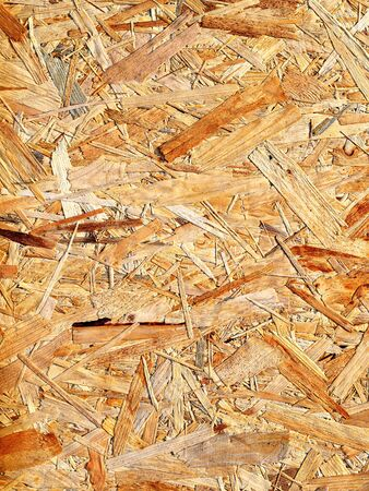 compressed: Sheet of plywood with fragments of compressed sawdust