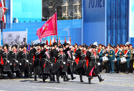 solemn: MOSCOW - MAI 7: Troops in military uniform of World War II in solemn march on Red Square - on Mai 7, 2015 in Moscow