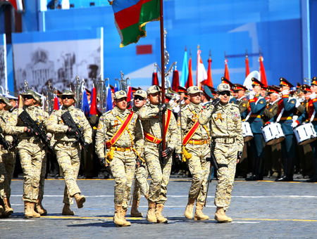 solemn: MOSCOW - MAI 7: Banner team of the Azerbaijan parade formation in solemn march on Red Square -; on Mai 7; 2015 in Moscow