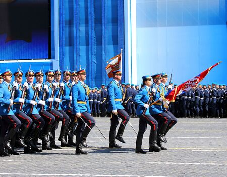 solemn: MOSCOW - MAI 7: Banner team of the serbian parade formation in solemn march on Red Square - on Mai 7, 2015 in Moscow