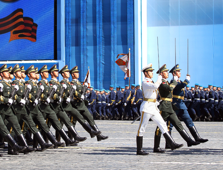 MOSCOW - MAI 7: Banner team of the chinese parade formation in solemn march on Red Square - on Mai 7, 2015 in Moscow