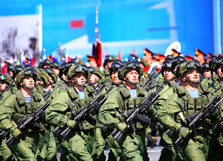 troops: MOSCOW - MAI 7: Troops in combat uniform in solemn march on Red Square - on Mai 7, 2015 in Moscow
