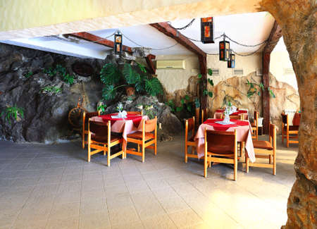 greenery: Interior of the restaurant decorated with rocks and greenery