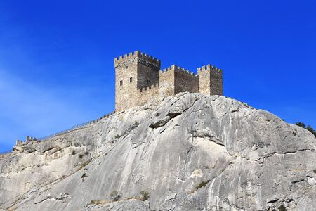 seventh: Three towers of the ancient seventh century citadel  on a rocks top