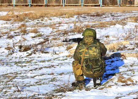 infantryman: Infantryman with a submachine gun in combat gear monitors the battlefield