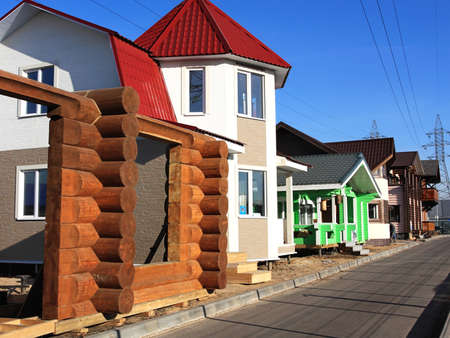cottages: Large-scale construction of wooden cottages Stock Photo
