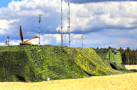 Camouflaged military object of the field radio communication complex