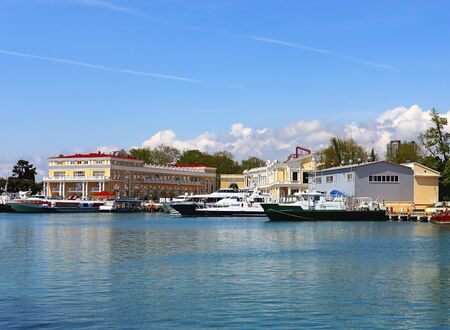 berth: Marine yachts and passenger vessels at berth on the background of the sea passenger port Stock Photo