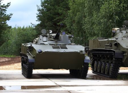 airborne vehicle: Airborne combat vehicle bmd-2 at the site in the forest Editorial