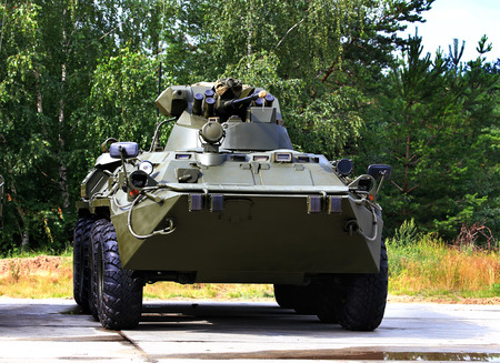 armoured: Armoured  vehicle for infantery transportation with 30 millimeter cannon and machine gun Editorial