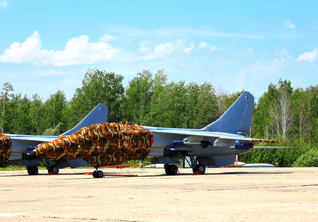 fighter jet: Chinese fighter jet parked at a military airbase