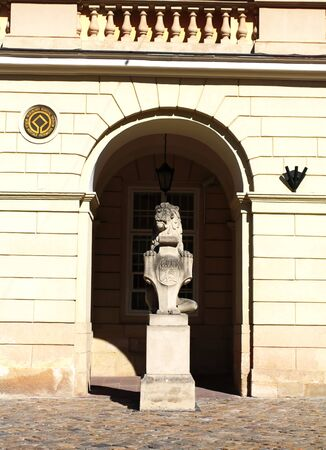 city coat of arms: Stone statue of a lion with coat of arms at the old City Hall in Lviv Stock Photo