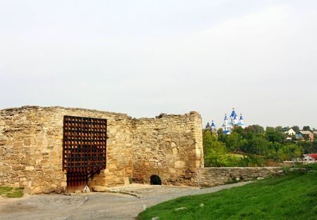 remains: Ancient citadel wall remains and entrance into the fortress Stock Photo