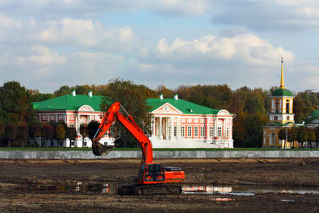dredging: Excavator makes dredging in the pond of the Moscow Kuskovo estate in Moscow