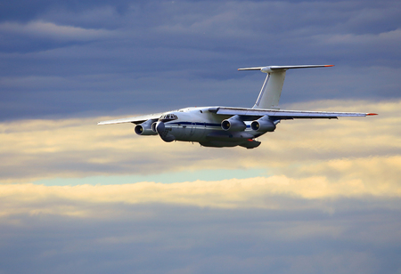 undercarriage: Heavy military cargo aircraft  flight in the morning sky