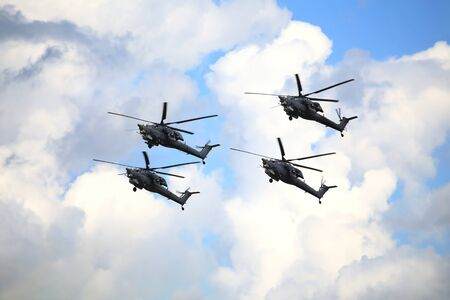 aircrew: Four modern russian attack helicopters Mi 28 at a low altitude