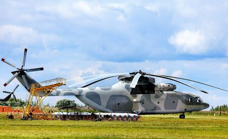 defense facilities: Modern russian military transport helicopter, airfield facilities and other technical equipment at the air base