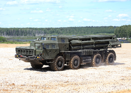 chassis: Multi launch rocket system with barrels   on the vehicle chassis on a march over rough terrain Editorial