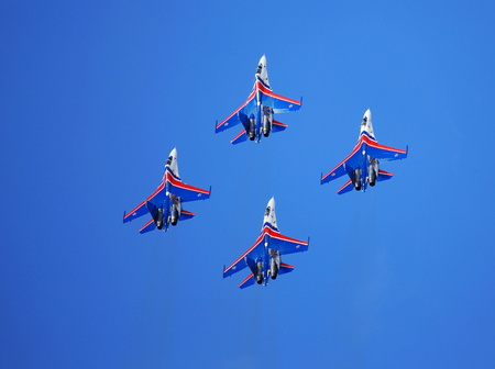 demonstrative: MOSCOW REGION - AUGUST 30: Demonstrative performance of the aerobatic team of Russian military aircrafts Swifts at the airshow on August 30, 2015 in Moscow region Editorial