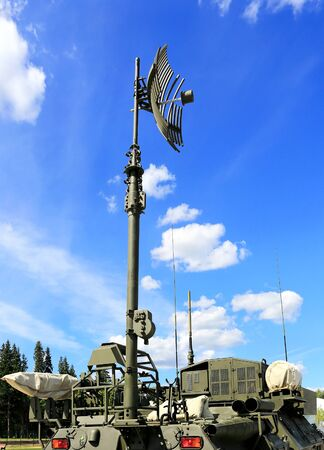 tracked: Military armored tracked vehicle with antennas for  field communication