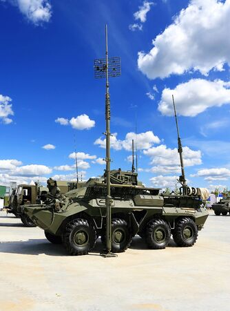 armored: Military armored tracked vehicle with antennas for  field communication